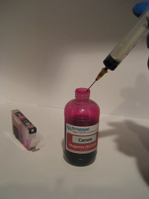Empty any excess ink back in the bottle